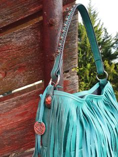 Three layers of ever loving fringe!  This bag is drop dead gorgeous!  Double J Saddlery Fringe Bag.  100% real leather.  Made in the USA!