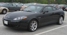 If a small sports car from Hyundai seems laughable to you, take another look at the automaker. Producing a quality model could help Hyundai strike gold. Small Sports Cars, Hyundai Cars, Grey, Hyundai Tiburon, Cutaway, Gray