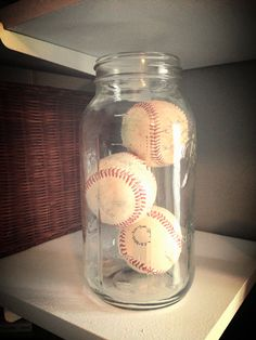 Super cute all baseballs to a glass jar. Maybe have guests sign the baseballs at the babyshower for 1st birthday party.