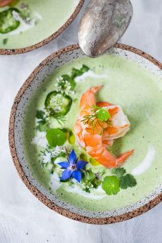 A refreshing flavorful recipe for Chilled Cucumber Soup with yogurt, cilantro, coriander and lime. Top this with shrimp or keep it vegetarian! So tasty. | www.feasingathome.com