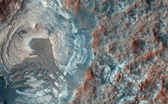 HiRISE photo of Mars, shows apparent layers exposed by the depression, especially on its sides or walls, overlain by dark sands presumably associated with the dark-toned unit.