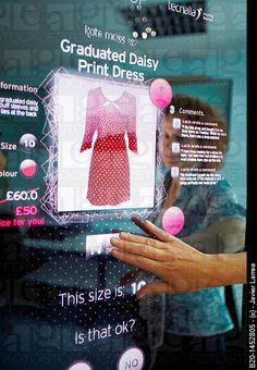 Interactive mirror that allows the person standing in front of it to see a simulated view of how the clothes would look.