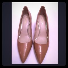 Coach nude pumps Beautiful patent leather nude pumps with leather sole comes with box nwot Coach Shoes Heels