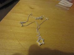 """New Listing Started NEW Silvertone Star pendant with clear stones on 18""""long nice chain £1.35"""