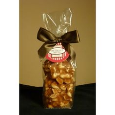 Revival Confections 6 ounce bag of our Spicy Peanut Brittle.  Our spicy peanut brittle is lovingly made by hand in very small batches.  There is just the right amount of sweet and spicy!  A very unique gift.