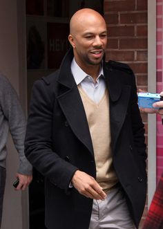 """Rapper Common flashes the peace sign after an appearance on """"The Wendy Williams Show"""" to promote his new movie """"Just Wright""""."""