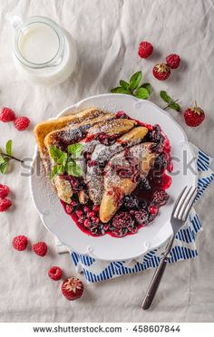 French toast with fruits and forest fruit reduction
