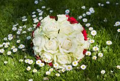 Elegant Bridal Bouquet With White Roses and Red Carnations