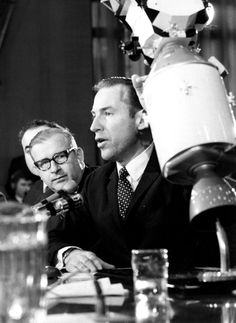 Astronaut James A. Lovell, Jr., Commander of the Apollo 13, relates to the members of the Senate Space Committee in an open session the problems of the Apollo 13 mission. In the background is Dr. Thomas O. Paine, NASA Administrator.