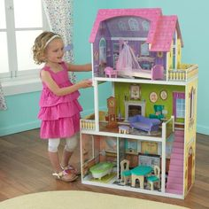Our whimsically detailed KidKraft Florence Dollhouse features fun, vibrant colors, two balconies and four rooms and stands nearly four feet tall. A cute canopy bed and splendid grandfather clock are included in the accessory pack. Wooden Dollhouse, Wooden Dolls, Dollhouse Dolls, Dollhouse Furniture, Dollhouse Ideas, Doll Toys, Barbie Dolls, Play Doll, Barbie Stuff