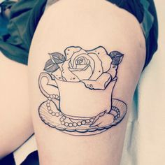 Teacup with flower tattoo