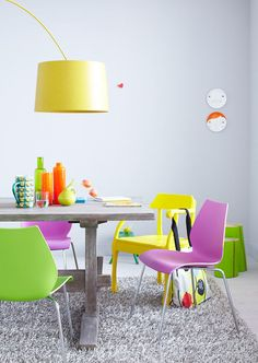 neon dining room. every chair a different color