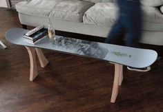 Check out this sweet project where a table is made from an old snowboard. An old skateboard could be used to make an end table as well maybe! Shredder Style - ReadyMade. Convert a thrashed board into a space-age coffee table.