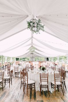 tented wedding with the most amazing wood floor