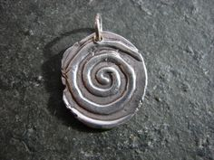 A spiral is a symbol believed to represent traveling from the inner life to the outer soul or higher spirit forms. In many different cultures it has come to be known as the symbol of growth and energy.