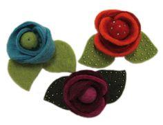 Felt flowers glued on headbands....I shall try!