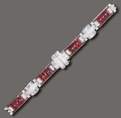 AN ART DECO RUBY AND DIAMOND BRACELET   The flexible band composed of four rectangular-cut ruby sections, spaced by pavé-set diamond arched links, each enhanced by baguette-cut diamond detail, mounted in platinum, (central panel originally contained a watch), circa 1935, 6½ ins