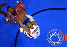 Oklahoma Citys Russell Westbrook (0) fights Houstons James Harden (13) for a rebound during Game 1 in the first round of the NBA playoffs between the Oklahoma City Thunder and the Houston Rockets