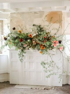 Love florals on mantels! So timeless and elegant!