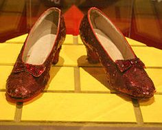 An original pair of ruby slippers used in The Wizard of Oz, on display at the Smithsonian Institution.(To create the ruby slippers, the shoes were dyed red, then burgundy sequined organza overlays were attached to each shoe's upper and heel)
