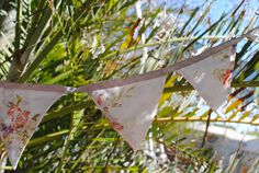 Up-cycled boho bunting / banner in multicoloured fabric on silver ribbon by FoxspawsDesigns on Etsy