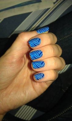Peppermint blue base with stamped on zebra pattern in a medium blue.