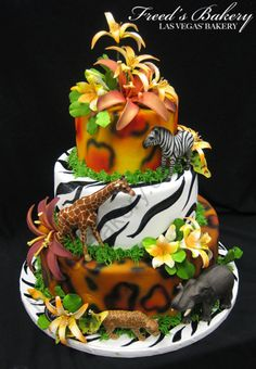 cool cake. can use toy plastic animals to cut cost on fondant animals and maybe less flowers so it can be more boyish. Also Would like to make one layer giraffe print.