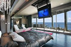 This is such an awesome bedroom! The tv is about the size of the bed!