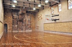 What dream home is complete without a indoor basketball court? There's a natural rock climbing wall as well.