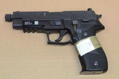 Sig P226 MK25 with factory threaded barrel.