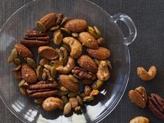 Ellie's healthy snack features a variety of nuts and seeds. Her Spiced Nuts get a hint of sweetness from maple syrup and a touch of spice from curry powder and cayenne pepper.