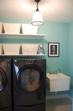 JCPenney black ribbon border velvet roman shade, damask ironing board cover, white floating shelves and The Container Store canvas baskets!  Pottery Barn vintage pendant  light!  Blue green turquoise laundry. Benjamin Moore Waterfall! Blue turquoise black cream white laundry room space.