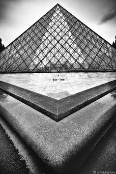 """Radiant Geometry"" Black and White Landscape Photography by Lynn Langmade - a monochrome photo of a beautiful symmetrical architecture at the Louvre in Paris, France"