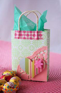 Now I know what to do with all my extra scrapbook paper! Make mini gift bags! Template here.