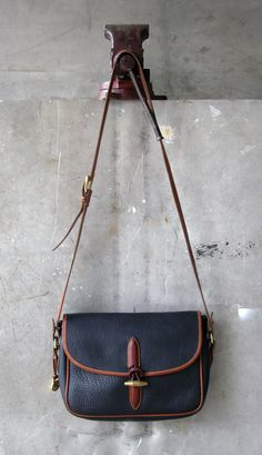 Dooney and Bourke Vintage Leather Bag: Navy or Black Crossbody Messenger with Braided Toggle. $110.00, via Etsy.