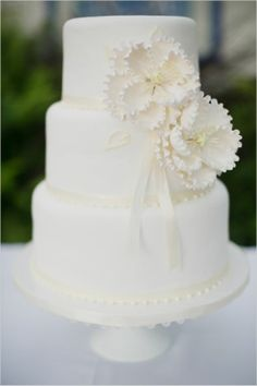 all white #wedding cake with sugar flowers {this modern romance}