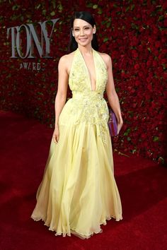 Lucy Liu In an embellished yellow halter gown by Zuhair Murad Couture with floral beaded details paired with a purple clutch.