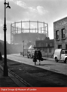 Gasworks at Nine Elms, Battersea, 1958 by Wolfgang Suschitzky. Museum quality art prints with a selection of frame and size options, and canvases. Museum of London Vintage London, Old London, South London, Vintage Photography, Street Photography, Colourful Photography, London History, Old Street, London Life