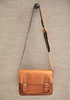 """Bright Days Crossbody Satchel In Tan 39.99 at shopruche.com. Perfect for adding polished refinement to your wardrobe, this structured  faux leather satchel in tan is finished  with an adjustable shoulder strap, gold colored hardware, and a spacious  interior.9.5"""" L x 6.5"""" H x 2.75 W, -20"""" adjustable strap drop, -1 interior zipper pocket, -1 exterior organizer pocket"""