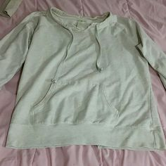 Cream hoodie Very comfy and warm. Goes well with light or dark jeans and has been slightly worn. Love the creme color scoop neck. Is a medium in juniors and provides a great slightly baggy fit. Offers are accepted and no trades. Please share (: green tea Sweaters Crew & Scoop Necks