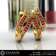 Look graceful even on a normal day with this elegant pair of earrings. This ruby earring has given a perfect finishing touch to this stunner. Gold Jhumka Earrings, Indian Jewelry Earrings, Jewelry Design Earrings, Gold Earrings Designs, Hoop Earrings, Gold Bangles Design, Gold Jewellery Design, Gold Jewelry Simple, Ear Rings