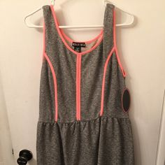 Skater dress Super cute never worn grey dress with  a neonish coral piping, awesome dress. ⭐️⭐️⭐️⭐️No trades or returns. I do however like to bundle. If you don't like the price please feel free to make an offer and we can go from there. Thanks for shopping and have a great day!⭐️⭐️⭐️⭐️⭐️⭐️⭐️⭐️⭐️⭐️ Dresses