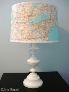 Cut maps into equal pieces and stick to lamp with Mod Podge - easy!