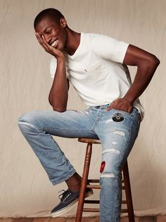 Take on summer with lightweight, distressed denim. Top it off with a classic white tee and navy sneakers. : Take on summer with lightweight, distressed denim. Top it off with a classic white tee and navy sneakers. Foto Portrait, Portrait Poses, Action Pose Reference, Sitting Poses, Handsome Black Men, Men's Wardrobe, How To Pose, Looks Vintage, Denim Top