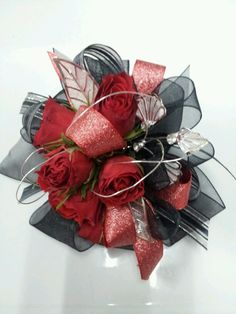 Red rose prom corsage. Silver and black accents.