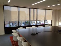 Roller blinds (mesh fabric) installed in Haymarket Boardroom