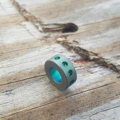 Titanium modular bead with stonewashed green grooved anodizing. tisurvival.com/ #tisurvival #titanium #lanyards #edc #lanyardbeads