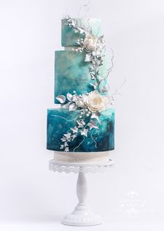 wedding cakes silver Turquoise, navy blue and white watercolor wedding cake with white and silver sugar flower arrangement - peony, roses, rose foliage and Ivy By the Turquoise Squirrel Patisserie Creative Wedding Cakes, Fall Wedding Cakes, Beautiful Wedding Cakes, Wedding Cake Designs, Beautiful Cakes, Wedding Desert, Wedding White, Silver Wedding Cakes, Wedding Cakes With Roses