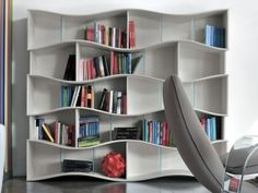 Onda Tonin Casa  It is a library in MDF lacquered, self-supporting with shelves of extra white and transparent crystal. Onda is a very nice and particular library because its structure is movable and changing. - See more at: http://www.martinelstore.com/en/prod/bookcase/onda-tonin-casa.html