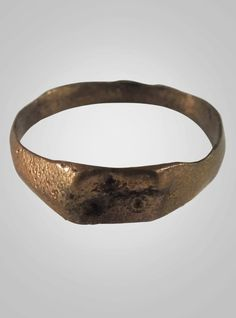 Woman's Gold over Bronze ring. C.13th-15th Century. Size 7 3/4 (18.1mm)(BRR564) Please Note: All of our rings are coated with a clear protective jewelers coating which inhibits any discoloration of th